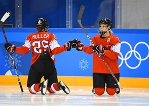 GANGNEUNG, SOUTH KOREA - FEBRUARY 12: Switzerland's Alina Muller #25 warms up with teammate Lara Stalder #7 during preliminary round action at the PyeongChang 2018 Olympic Winter Games. (Photo by Matt Zambonin/HHOF-IIHF Images)