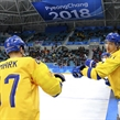 GANGNEUNG, SOUTH KOREA - FEBRUARY 15: Sweden's Linus Omark #67 celebrates at the bench with John Norman #37 after a first period goal against Norway during preliminary round action at the PyeongChang 2018 Olympic Winter Games. (Photo by Andre Ringuette/HHOF-IIHF Images)
