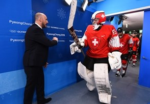 GANGNEUNG, SOUTH KOREA - FEBRUARY 15: Switzerland's Leonardo Genoni #63 fist bumps assistant coach Christian Wohlwend walking out to warmup during preliminary round action at the PyeongChang 2018 Olympic Winter Games. (Photo by Matt Zambonin/HHOF-IIHF Images)