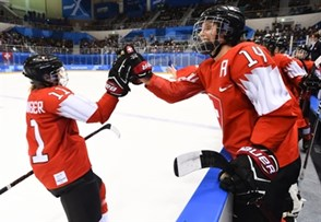 GANGNEUNG, SOUTH KOREA - FEBRUARY 18: Switzerland's Sabrina Zollinger #11 high fives Evelina Raselli #14 after scoring a first period goal on Team Korea during classification round action at the PyeongChang 2018 Olympic Winter Games. (Photo by Matt Zambonin/HHOF-IIHF Images)