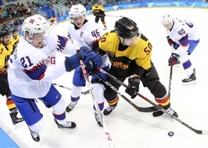 GANGNEUNG, SOUTH KOREA - FEBRUARY 18: Germany's Patrick Hager #50 battles for the puck with Norway's Steffen Thoresen #21, Mathis Olimb #46 and Ken Andre Olimb #40 during preliminary round action at the PyeongChang 2018 Olympic Winter Games. (Photo by Andre Ringuette/HHOF-IIHF Images)