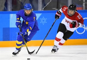 GANGNEUNG, SOUTH KOREA - FEBRUARY 18: Sweden's Johanna Olofsson #7 stickhandles the puck away from Japan's Shoko Ono #27 during classification round action at the PyeongChang 2018 Olympic Winter Games. (Photo by Matt Zambonin/HHOF-IIHF Images)