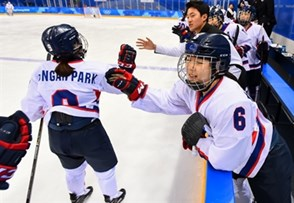 GANGNEUNG, SOUTH KOREA - FEBRUARY 20: Korea's Jongah Park #9 high fives Yujung Choi #6 after a first period goal scored by Soojin Han #17 (not shown) on Team Sweden during classification round action at the PyeongChang 2018 Olympic Winter Games. (Photo by Matt Zambonin/HHOF-IIHF Images)