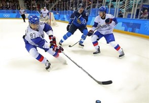 GANGNEUNG, SOUTH KOREA - FEBRUARY 20: Korea's Minho Cho #87 plays the puck while Won Jun Kim #6 keeps close watch on Finland's Joonas Kemppainen #23 during qualifaction round action at the PyeongChang 2018 Olympic Winter Games. (Photo by Andre Ringuette/HHOF-IIHF Images)