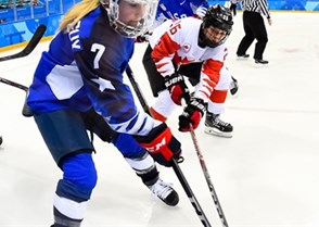 GANGNEUNG, SOUTH KOREA - FEBRUARY 22: USA's Monique Lamoureux-Morando #7 stickhandles the puck with Canada's Emily Clark #26 chasing during gold medal round action at the PyeongChang 2018 Olympic Winter Games. (Photo by Matt Zambonin/HHOF-IIHF Images)