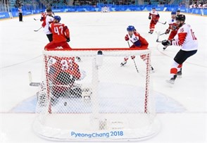 GANGNEUNG, SOUTH KOREA - FEBRUARY 24: Canada's Chris Kelly #11 gets the puck past Czech Republic's Pavel Francouz #33 to score a first period goal with Michal Jordan #47, Petr Koukal #42 and Canada's Quinton Howden #16 looking on during bronze medal round action at the PyeongChang 2018 Olympic Winter Games. (Photo by Matt Zambonin/HHOF-IIHF Images)